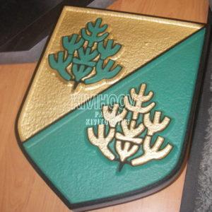 Nõmme logo graniidist, kiviraie on värvitud